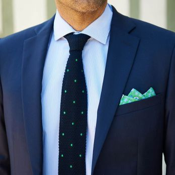 Green pocket square with flowers and paisley patterns