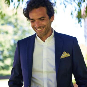 Yellow pocket square with flowers and paisley patterns